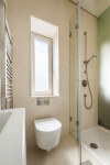 Small, modern bathroom interior design with shower